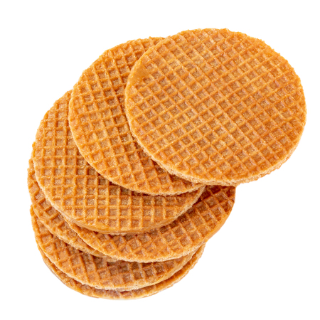 Pile of caramel  round Dutch waffles isolated on white background. Top view