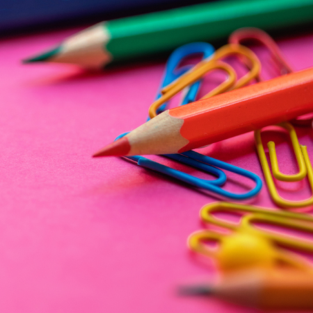 Back to school. School supplies  on colorful  background for classes and lessons.  Flat lay. Top view