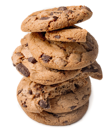 Stack of Chocolate chip cookies with chocolate chunks  isolated on white background.  Close up. Junk food concept Banco de Imagens