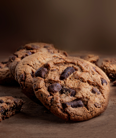 Chocolate chip  cookies on wooden Background, copyspace, top view
