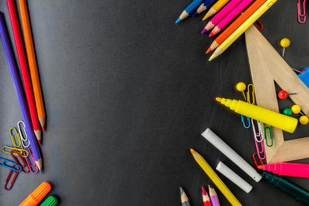 Back to school. School supplies  on blackboard background for classes and lessons.  Flat lay. Top view Banco de Imagens - 123453091