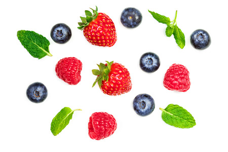 Various fresh summer berries  isolated on white background, top view. Strawberry, Raspberry, Blueberry and Mint leaf, flat lay Banco de Imagens