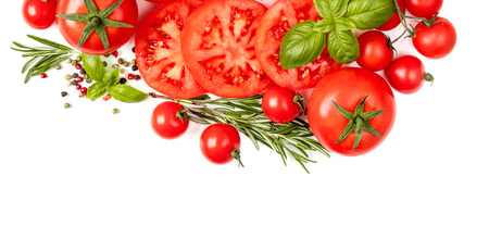 Creative border made of  fresh vegetables, herbs and spices. Various colorful tomatoes and basil leaves isolated on white background.  Flat lay. Top view Banco de Imagens - 123453152