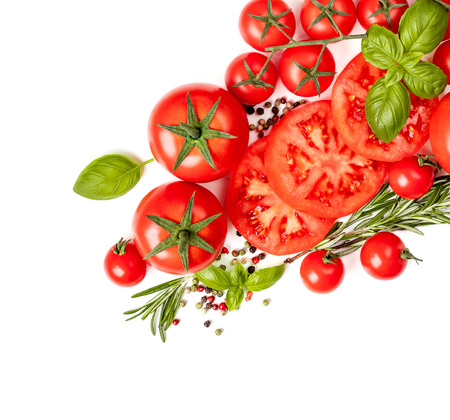 Various colorful tomatoes with  basil leaves, herbs and spices isolated on white background.  Flat lay. Top view