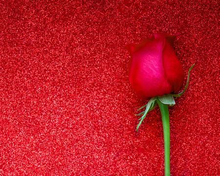 Happy Valentines day greeting card with red rose on glittering background with copyspace. Flat lay