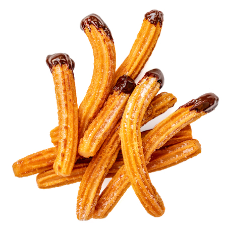 Churros - fried dough pastry with sugar and chocolate sauce dip isolated on a white background. Churro sticks, traditional Spanish snack Banco de Imagens