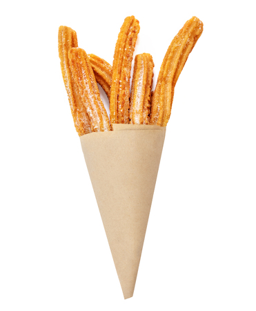 Churro stick in apaper bag.  Churro - Fried dough pastry with sugar powder isolated on a white background.  Close up Banco de Imagens - 124565113