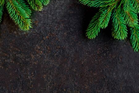 Christmas  background with fir branches on black stone  board with copyspace