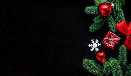 Christmas decoration on dark black background. Flat lay. Christmas wallpaper with copy space