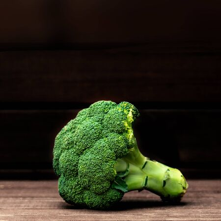 Broccoli  vegetable on a dark background. Copy space. Fresh Broccoli closet up. Organic Food concept Banco de Imagens - 124565194