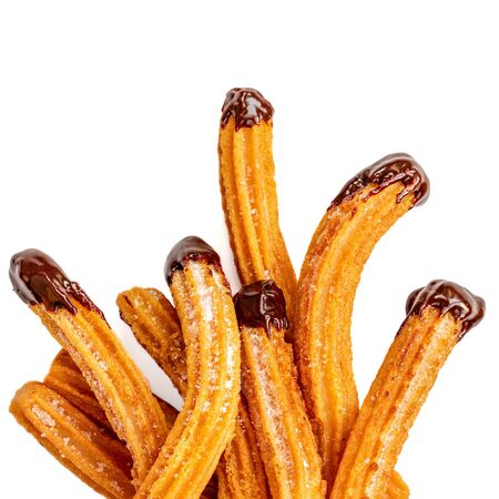 Churros - fried dough pastry with sugar and chocolate sauce dip isolated on a white background. Churro sticks, traditional Spanish snack Banco de Imagens - 124565207
