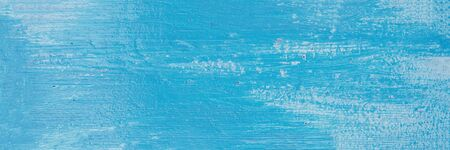 Light blue abstract wood texture background. Bright Wooden desk  with peeling paint. Copy space