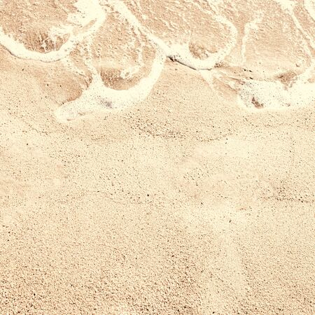 Sand textured  Background. Soft wave on sandy beach. Summer  Vacation concept