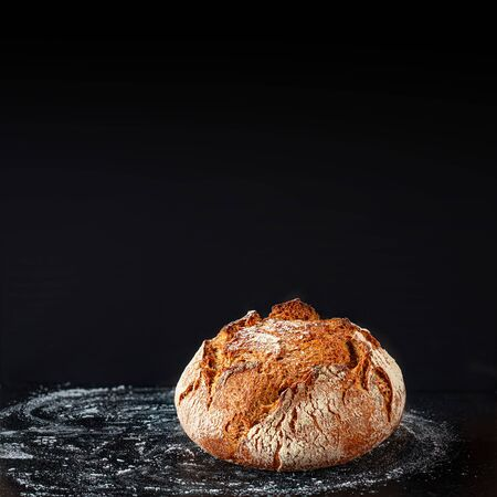 Bread background. Fresh bread on dark board. Close-up. Bakery concept. Rustic style