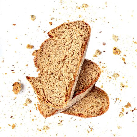 Bread toast with Crumbs isolated on white background. Fresh Bread slices close up. Top view