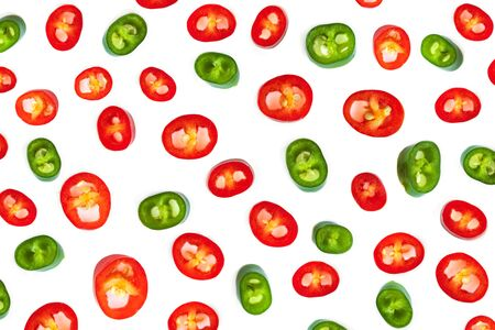 Red chili pepper Pattern. Slices of Cayenne pepper isolated on white background