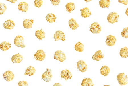 Popcorn Pattern. Caramel popcorn isolated on white background. Food, cinema, movie or film design. Flat lay Banco de Imagens