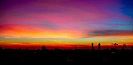 Colorful sunset sky. Beautiful Panorama view of Barcelona city in Spain with dramatic light.