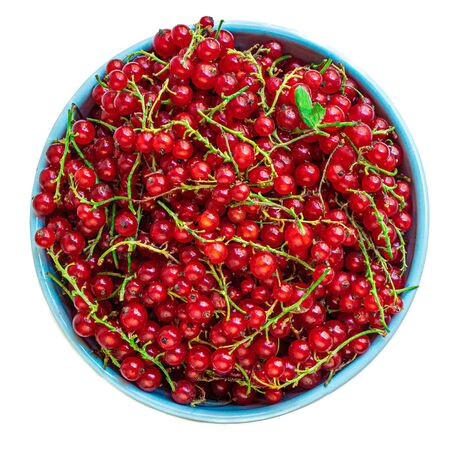 Red currant berries in a bowl with leaves  isolated on white background. Heap of Fresh Currant. Top view. Banco de Imagens