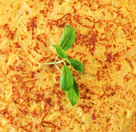 Spanish omelette  background. Traditional dish from Spanish cuisine with eggs and potato -  tortilla de patatas. Top view