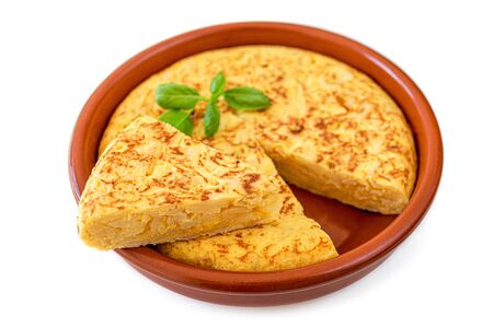 Omelet made of eggs and potatoes  isolated on white background. Spanish Omelette - Traditional tortilla tapas de patatas Banco de Imagens