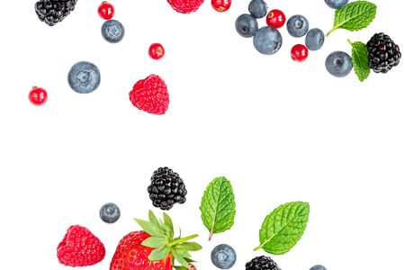 Isolated Falling Berries. Flying Strawberry, Raspberry fruits, Cranberry, Blueberry and Mint leaf. Creative Layout. Macro