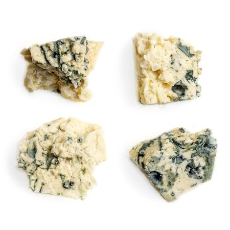 Blue cheese pieces Isolated. Mold cheese  on a white background. Food concept, close up. Flat lay Reklamní fotografie