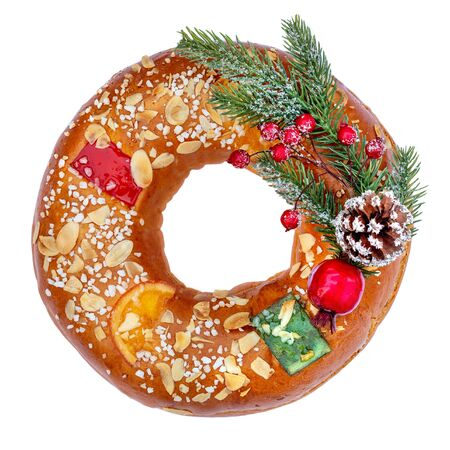 Christmas fruit cake decorated with fir tree branch, glazed fruits  and nuts isolated on white background.  Roscon de reyesÑŽ Top view Reklamní fotografie