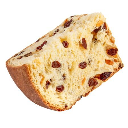 Piece of Christmas cake panettone. Delicious  Christmas cake with raisins  isolated on white  background.