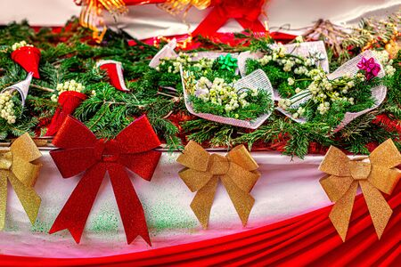 Christmas Gifts  with  fir tree branches, Mistletoe plant and Xmas decorations on a market. Happy new year Background.