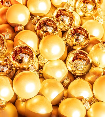 Heap of Golden Christmas balls, may use as Background. Close up. Traditional Xmas and Happy New Year  Symbol.
