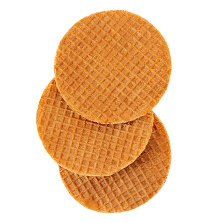 Dutch Caramel waffles with caramel and honey isolated on white background. Round stroopwafel Top view Reklamní fotografie