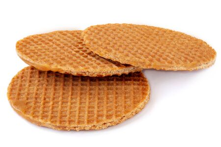 Round dutch waffles with caramel and honey isolated on white background. Caramel stroopwafels Side view. Close-up.