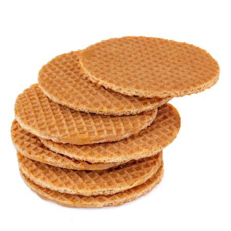 Pile of round dutch waffles with caramel and honey isolated on white background. Caramel stroopwafels Side view. Close up.