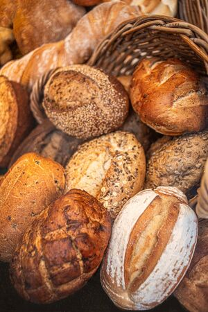 Mixed Fresh Bread as background, top view.  Rustic loaves of bread close up.   Food concept Reklamní fotografie