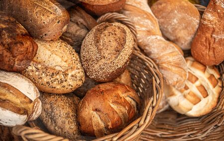 Assortment of Fresh Bread as background, top view.  Rustic loaves of bread close up.