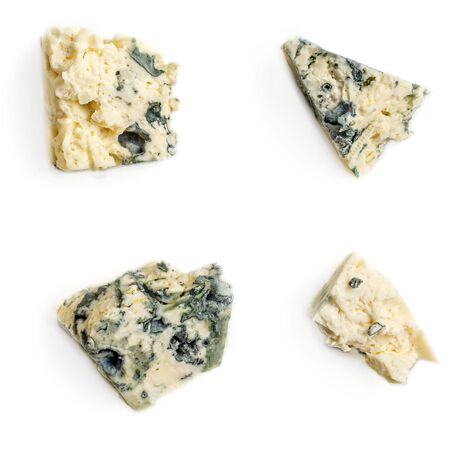 Collection of Blue cheese pieces. Smelling cheese isolated on a white background. Food concept, close up. Flat lay Reklamní fotografie