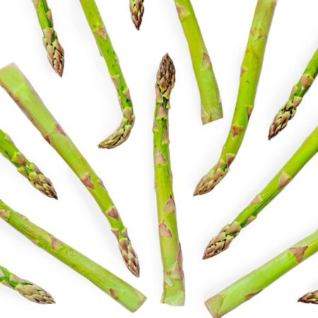 Asparagus Pattern. Creative layout made of fresh asparagus isolated on white background close up. Top view Stock Photo