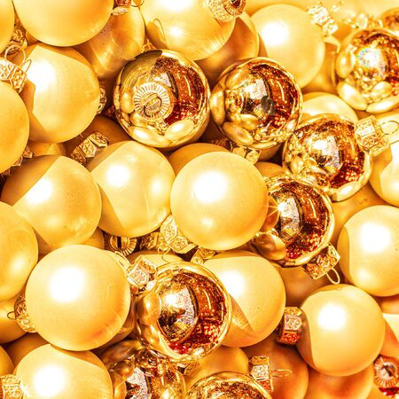 Gold Christmas balls, may use as Background. Close up. Traditional Xmas and Happy New Year Symbol.