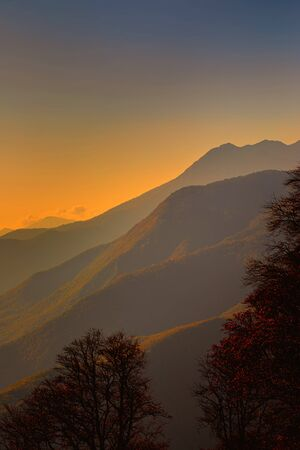 Autumn Mountains Landscape. Mountain peaks at sunset