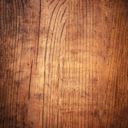 Old grunge dark natural wooden shabby background close up. Wood texture or cutting board