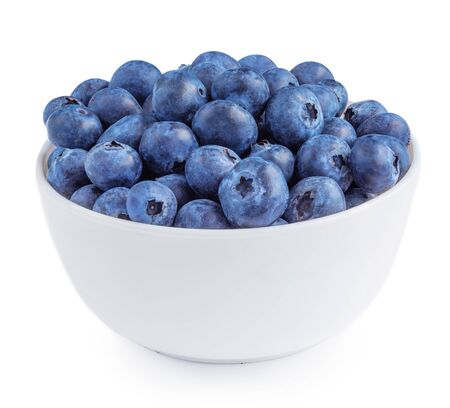 Blueberries isolated on white background. Freshly picked blueberries in a bowl. Bilberry antioxidant concept.