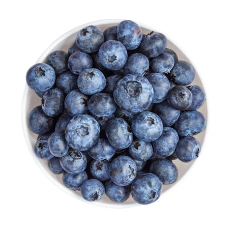 Fresh Blueberries isolated on white background. Blue forest berries in a bowl top view.  Macro Banco de Imagens