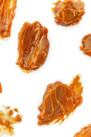 Caramel Pattern. Soft melted caramel isolated on white background, top view Banco de Imagens