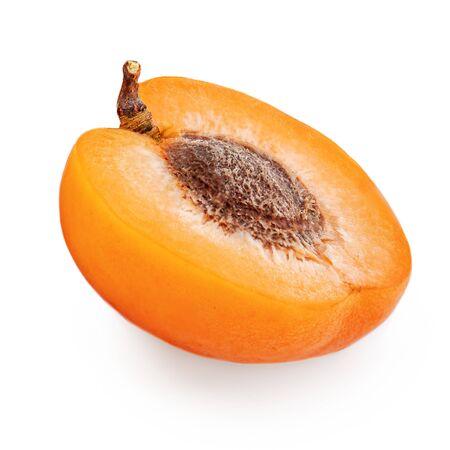 Fresh Apricots. Halved Apricot fruit isolated on the white background.  Macro Banco de Imagens