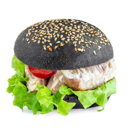 Tasty grilled meat burger with lettuce and mayonnaise  isolated on white background. Black Burger.  Fast Food Banco de Imagens