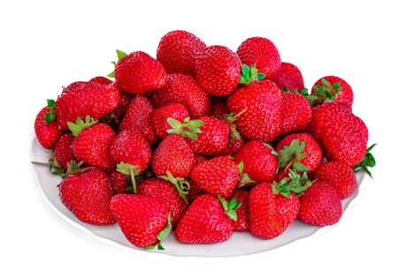 Strawberry fruits. Fresh strawberries on a plate  isolated  on white background close up. Banco de Imagens