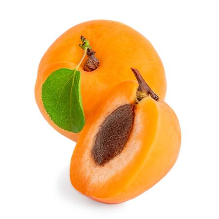 Apricot isolated. Fresh Apricot with leaves on white macro.
