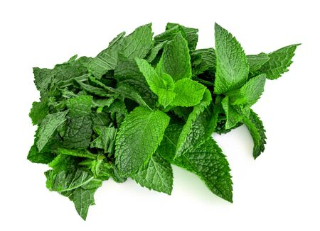 Chopped Fresh spearmint leaves isolated on the white background. Mint, peppermint close up
