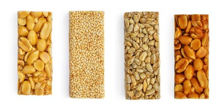 Various Granola Nut  Bars Isolated on White Background. Healthy Energy bars with peanut, sesame and caramel Top view
